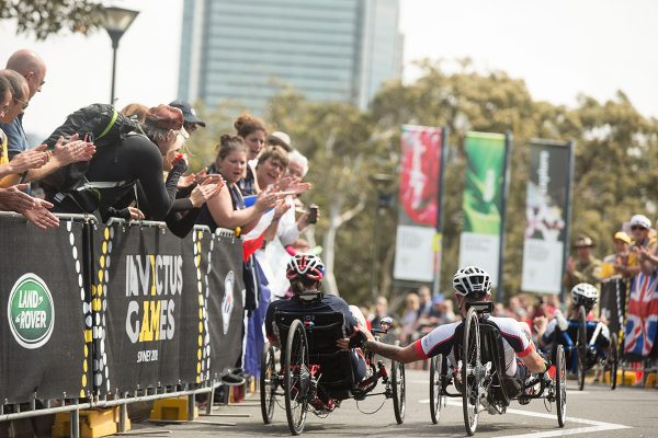 SYDNEY, AUSTRALIA - OCTOBER 21:  Michael Matthews helps follow UK team member Karen Fisk in the IRECB1 Mens and Women's Criterium at the Invictus Games Sydney 2018 on October 21, 2018 in Sydney, Australia.  (Photo by Jessica Hromas/Getty Images for Invictus Games Sydney)